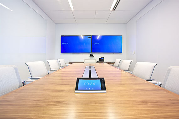 audio visual boardroom including 2 screens and a touch panel