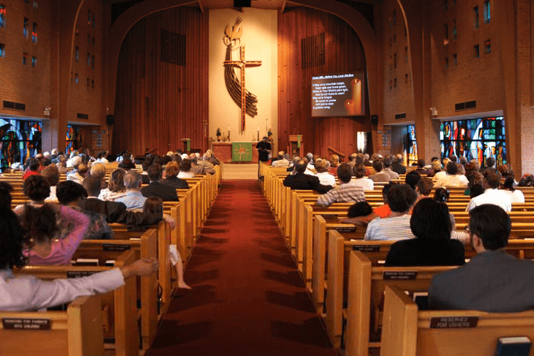 church with people sitting in pews