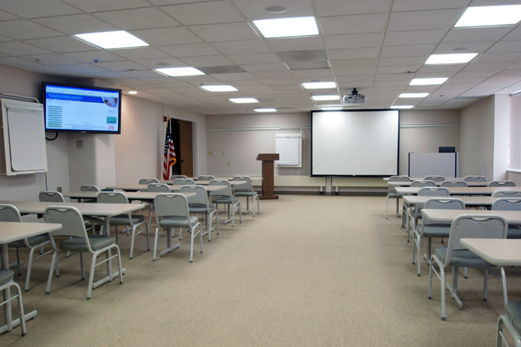 large display and projector in a classroom