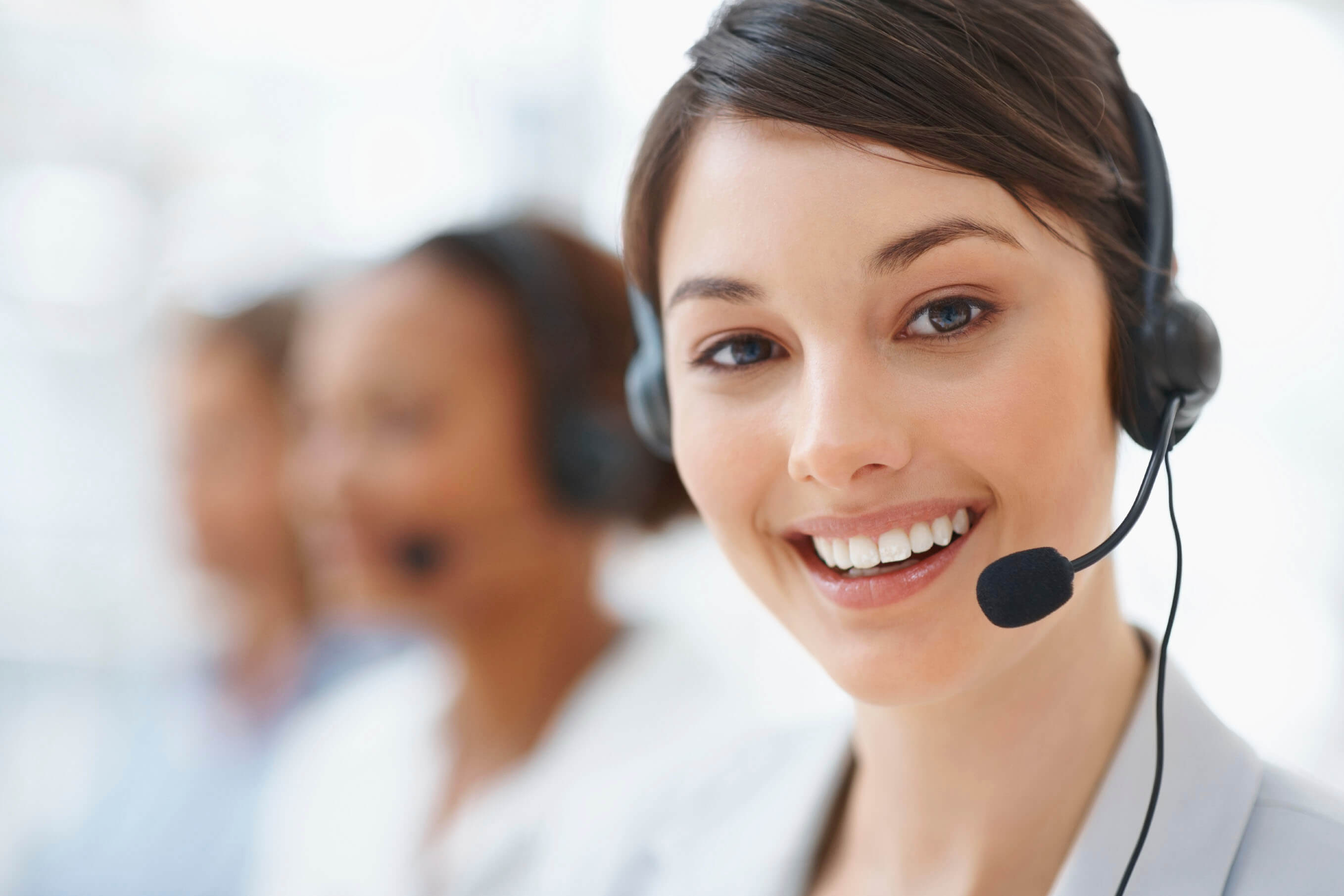 a woman speaking on a headset phone