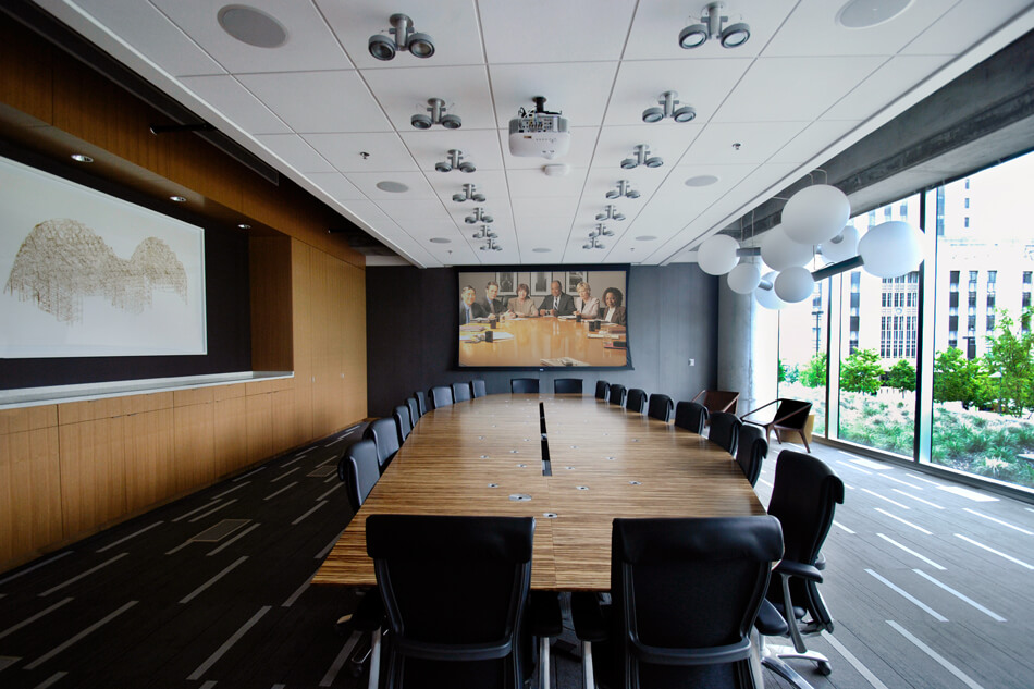 boardrooms with microphones, lighting and a projector