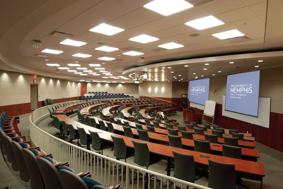 university lecture hall with two projector screens