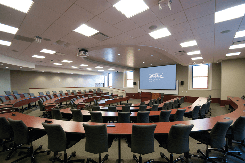 university lecture hall featuring a projector and screen