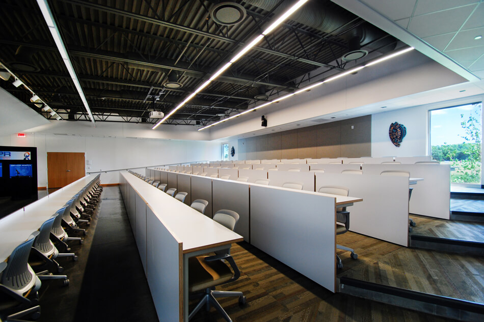multipurpose room with five rows of seating and a projector