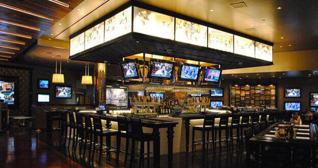 video screens above casino bar
