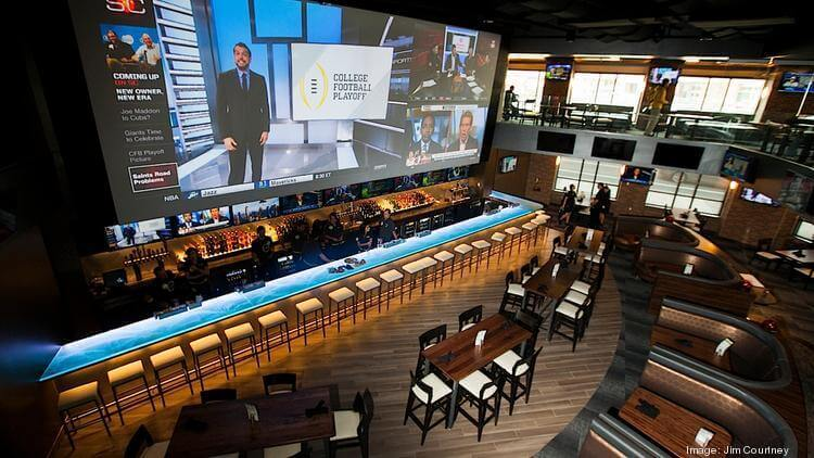 sports bar with very large projector screen