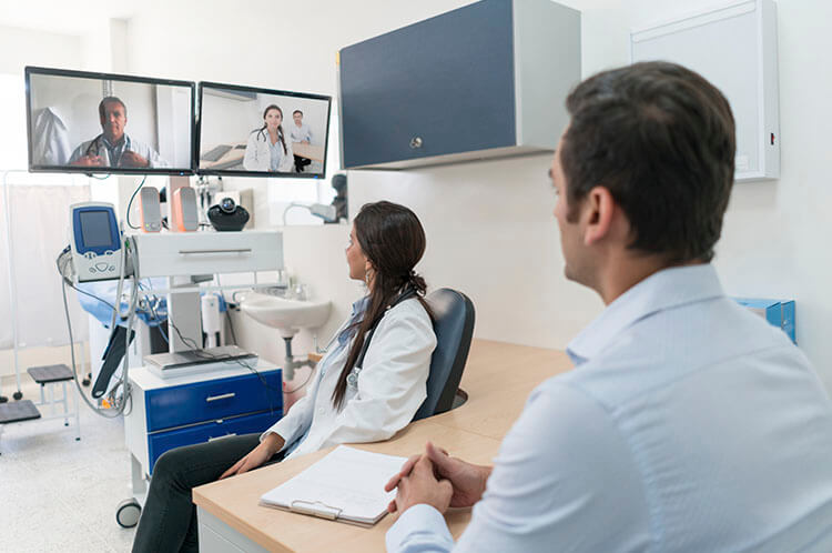 doctors in a video conference in a hospital setting