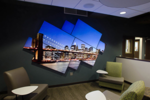 video wall configuration with landscape photo in a lobby study space