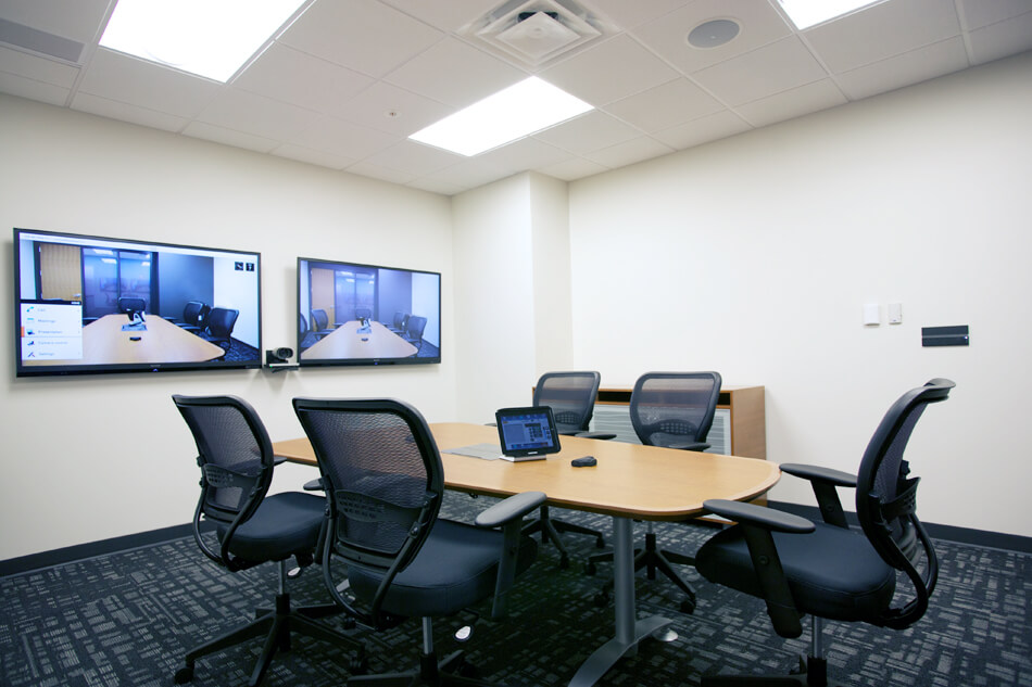 small group meeting room with dual displays, camera and a touch panel