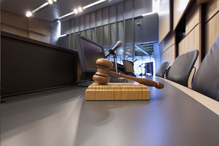 Judge's view with gavel, microphones and monitors