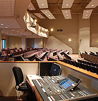church audio visual table with sound board, a monitor and stereo