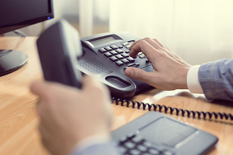 Desk phone system in use