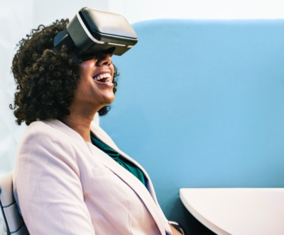 a woman using a VR device and smiling