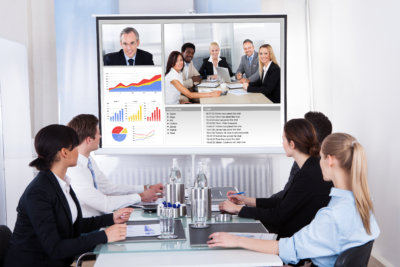 Businesspeople Sitting In A Conference Room Looking At Screen, virtual meeting