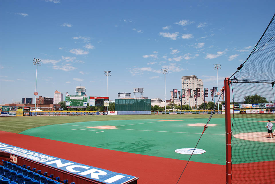view from behind the dugout at a baseball stadium