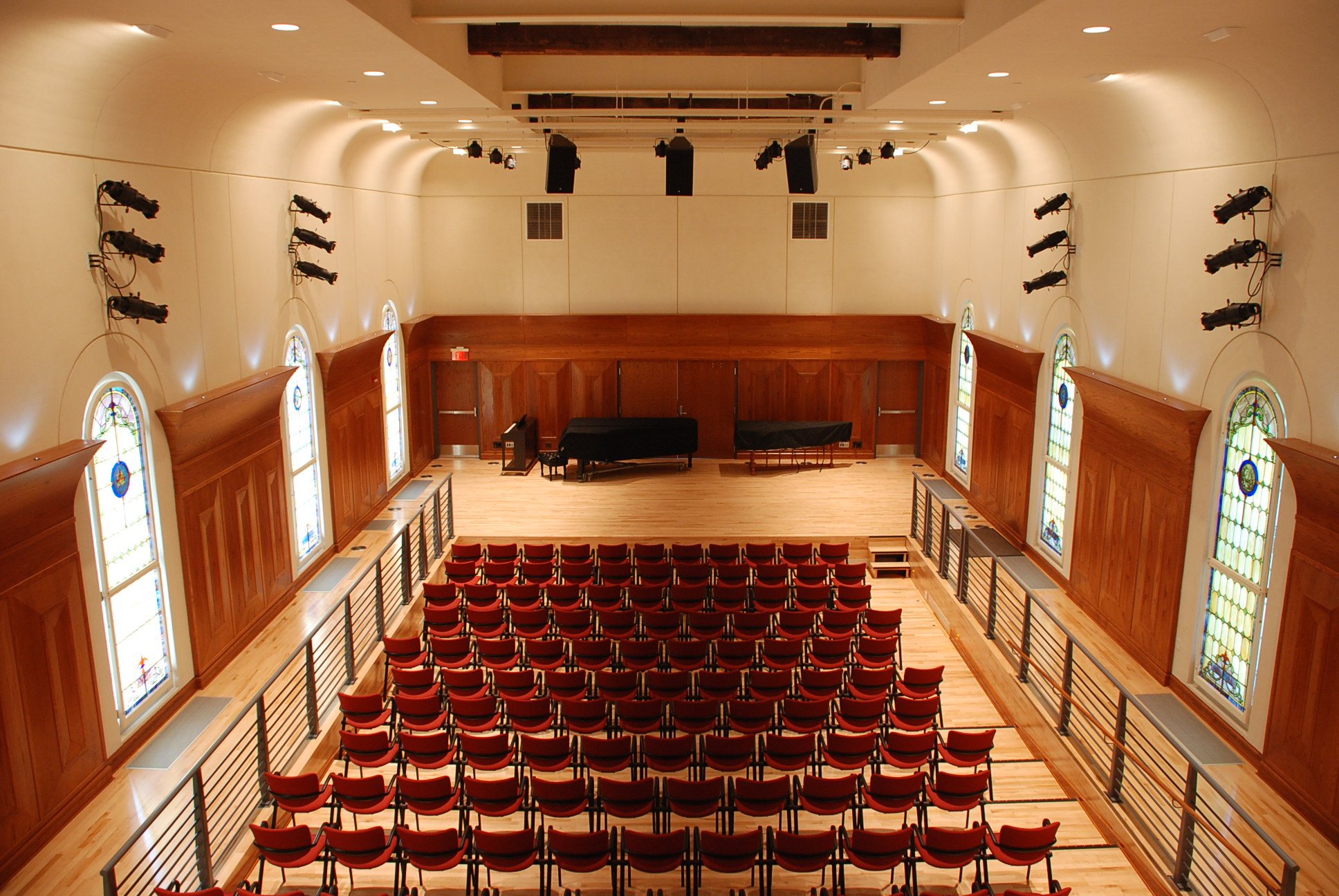 large auditorium with speakers