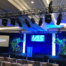 lighting, digital display and podium at a conference