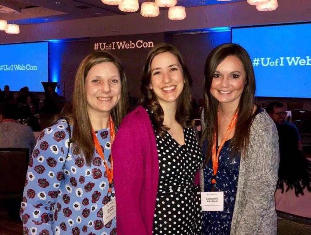 three CTI employees at a conference