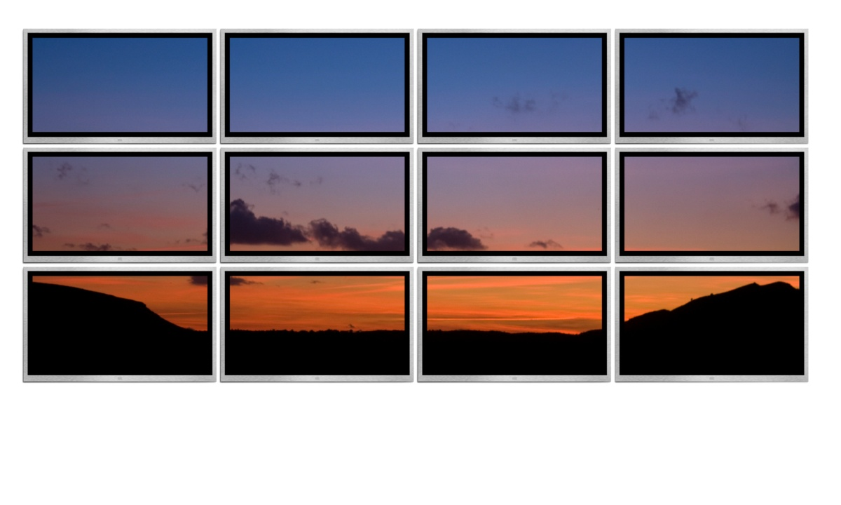 Wall of 12 TV screens showing a single image