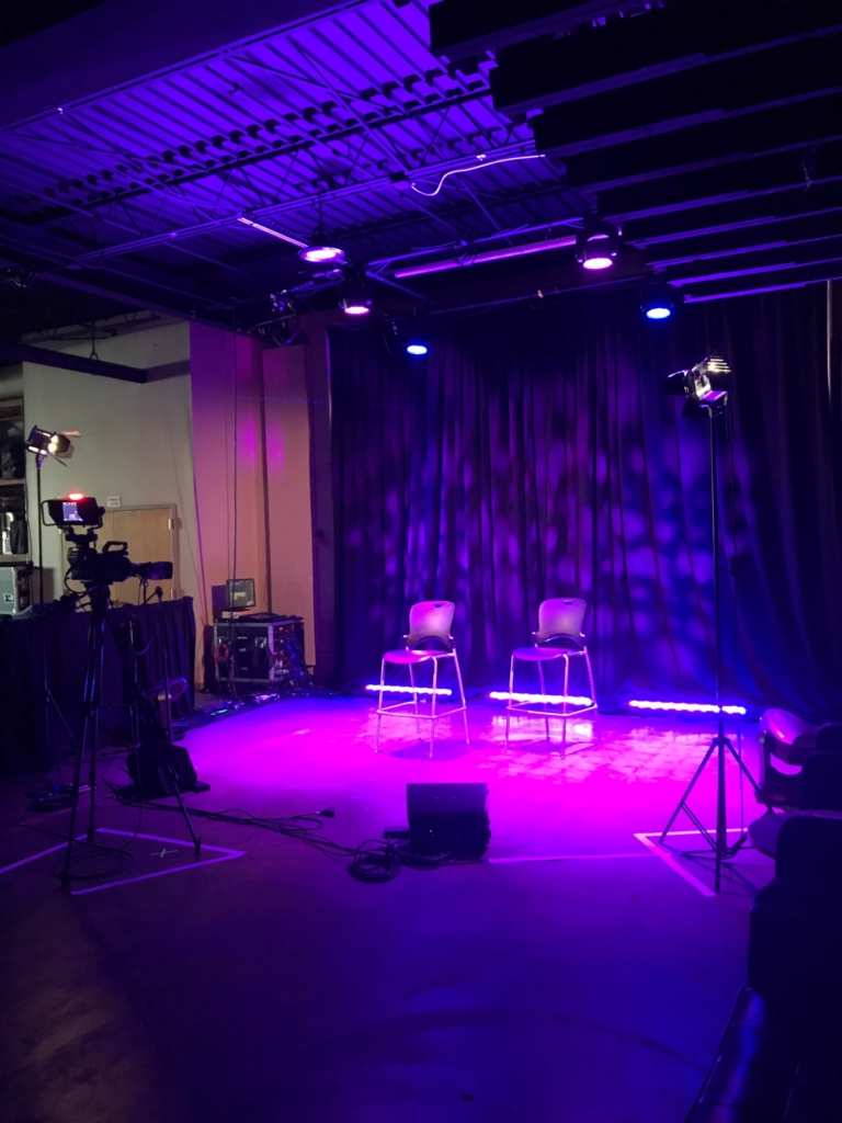 two chairs on stage with custom lighting