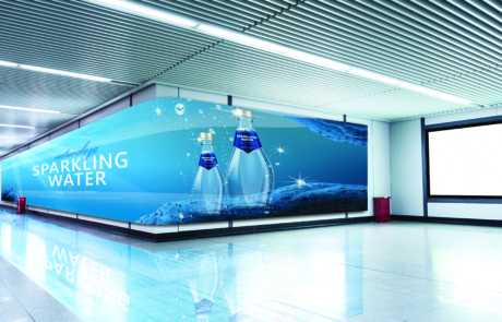 curved digital signage along an airport wall