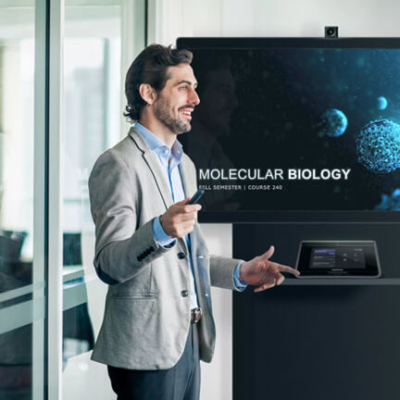 Man giving a presentation next to a display and touch panel
