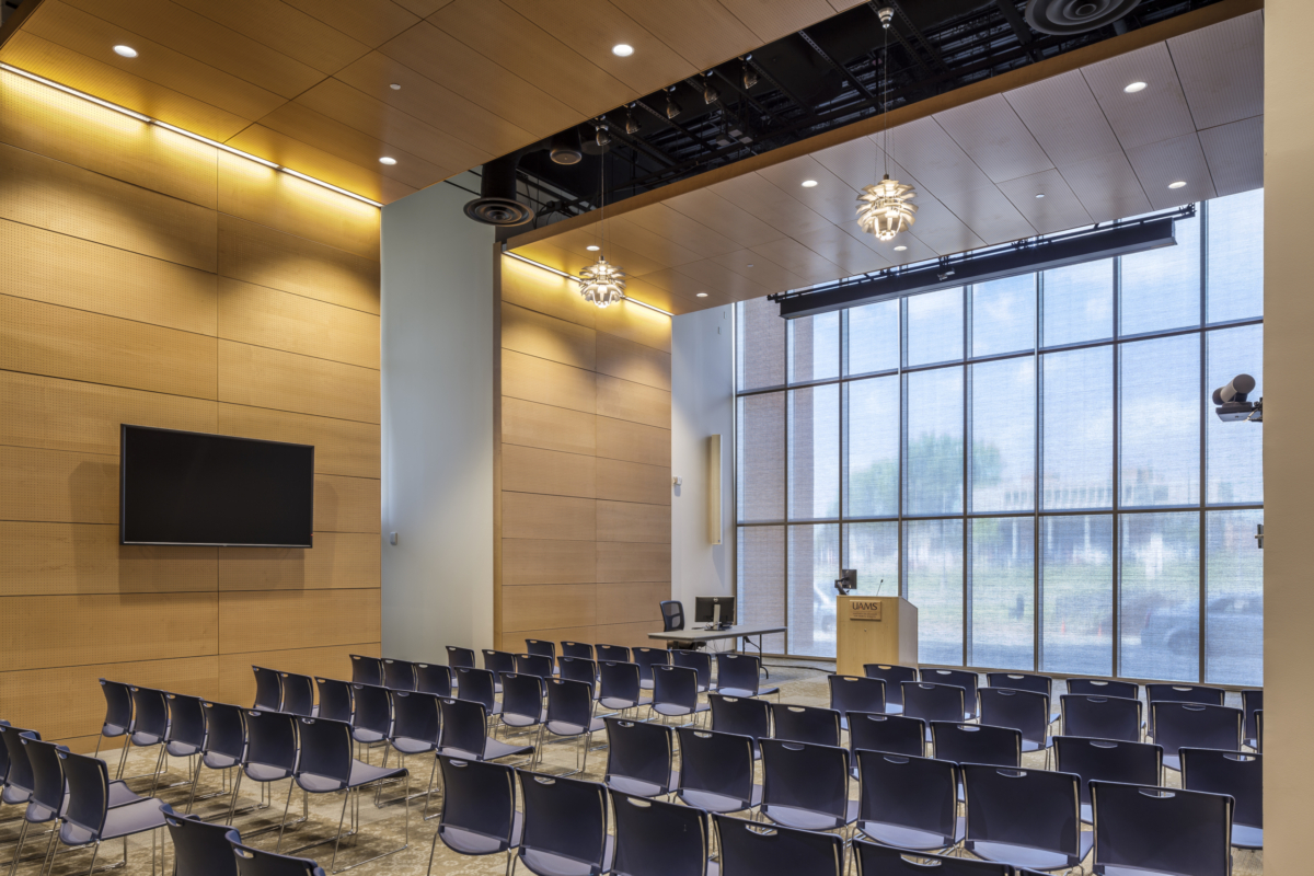 lecture hall with large display, speakers projector and podium