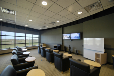 college classroom with mounted displays make for optimal higher education technology