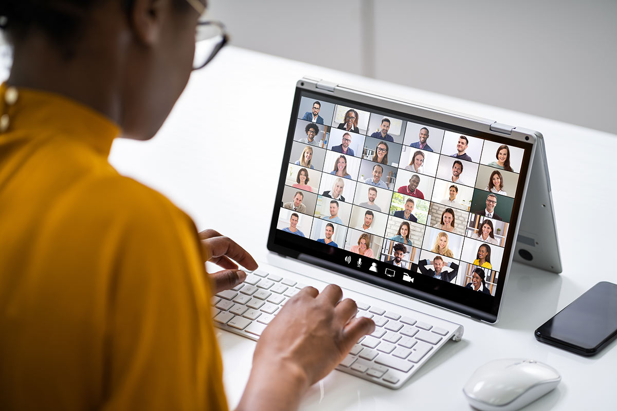 woman in a video call with many participants