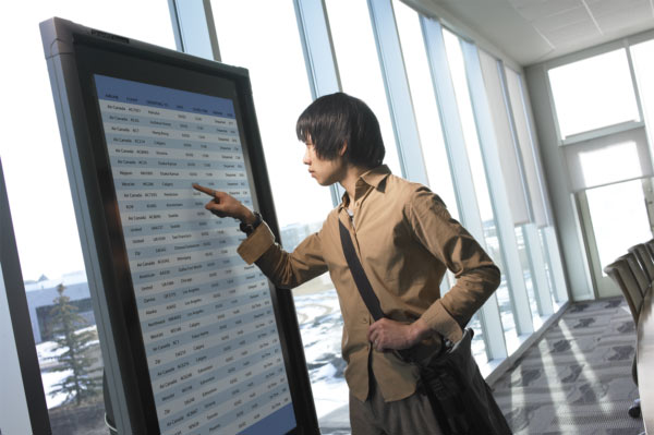 woman with video wall
