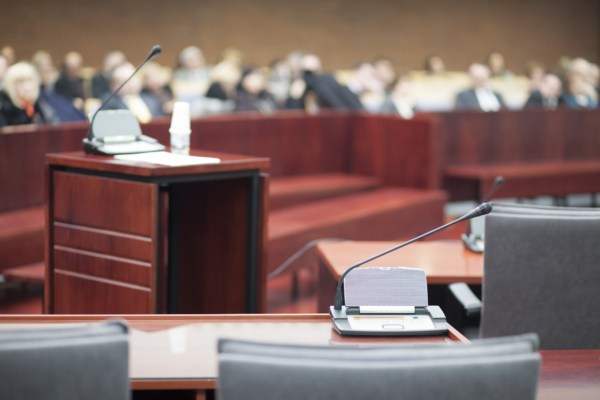 full courtroom view with court technology at the witness stand